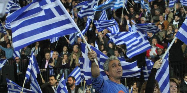 ATHENS, GREECE - JANUARY 23: Supporters of the New Democracy party wave Greek national flags during Greek...