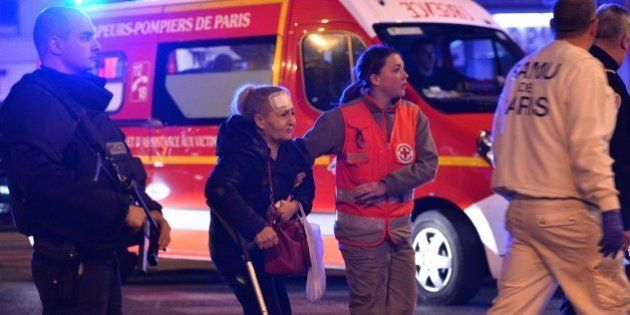 PARIS, FRANCE - NOVEMBER 14: Medics carry the woundeds to the ambulances near Le Petit Cambodge restaurant...