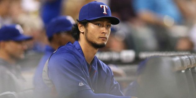 CHICAGO, IL - AUGUST 05: Yu Darvish #11 of the Texas Rangers watches a game against the Chicago White...