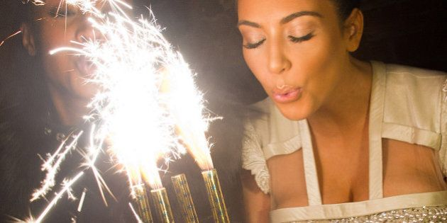 Kim Kardashian blows out the candles on a cake in celebration of her 30th Birthday at the 10th Anniversary...