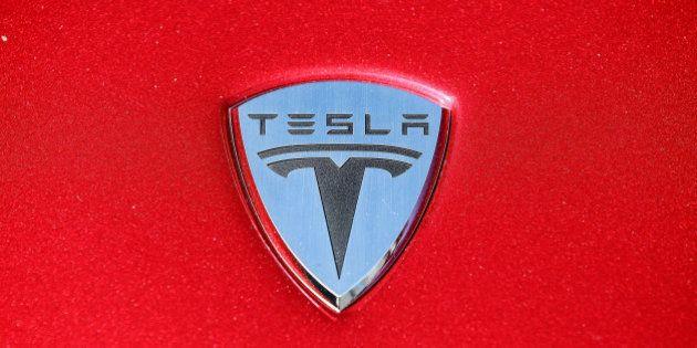 PALO ALTO, CA - MAY 20: The Tesla Motors logo is seen on the hood of a car at Tesla Motors headquarters...