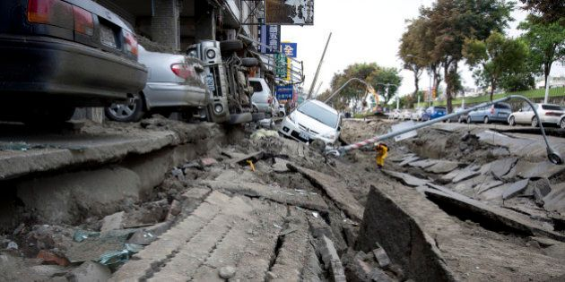 KAOHSIUNG, TAIWAN - AUGUST 01: Vehicles lie on the damaged road after gas explosions in southern Kaohsiung...