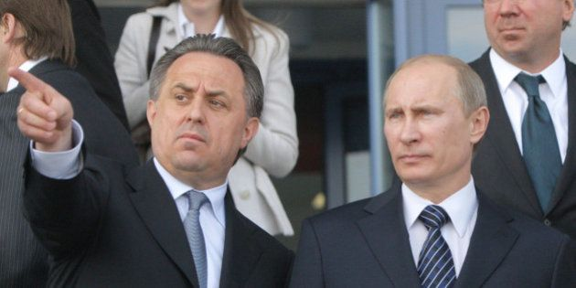 FILE - In this May 16, 2011 file photo then Russian Prime Minister Vladimir Putin, right, is flanked...