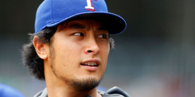 NEW YORK, NY - JULY 24: Yu Darvish #11 of the Texas Rangers looks on from the dugout in the first inning...