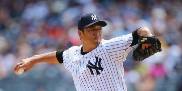 NEW YORK, NY - AUGUST 10: Hiroki Kuroda #18 of the New York Yankees pitches against the Cleveland Indians...