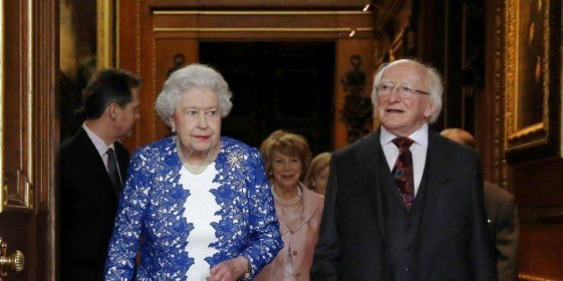 Britain's Queen Elizabeth II and Irish President Michael D Higgins attend a Northern Ireland-themed reception...