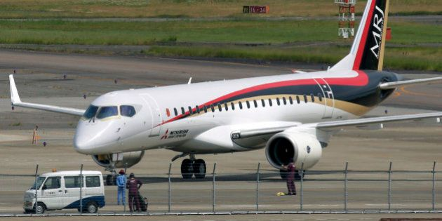 A Mitsubishi Regional Jet (MRJ) passenger aircraft, developed by Mitsubishi Aircraft Corp., taxies during...
