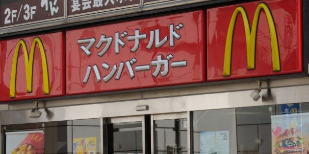 A man enters a McDonald's restaurant, operated by McDonald's Holdings Co. Japan Ltd., in Tokyo, Japan,...