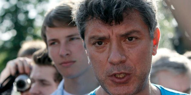 Russian opposition leader Boris Nemtsov speaks to youth opposition protesters, evicted by police from...