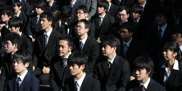 Vocational school students attend a rally to start off job-hunting in Tokyo, Japan, on Wednesday, Jan....