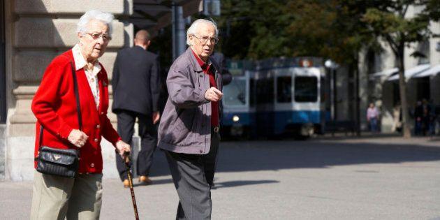 SWITZERLAND - SEPTEMBER 27: An eldery couple walk on the Paradeplatz in Zurich, Switzerland, Wednesday,...