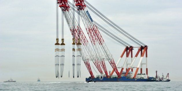 A giant offshore crane is seen near the site of a capsized ferry at sea off Jindo on April 18, 2014....