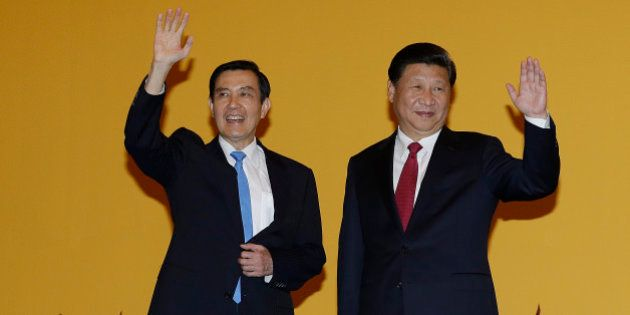 Chinese President Xi Jinping, right, and Taiwanese President Ma Ying-jeou, left, wave to the media at...