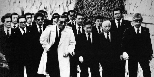 Top members of the Yamaguchi-gumi Japan's largest Yakuza Organization, arrive for the funeral in Kobe,...