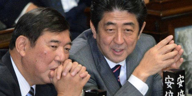 Shinzo Abe (R) chats with Secretary General of the Liberal Democratic Party (LDP) Shigeru Ishiba (L)...