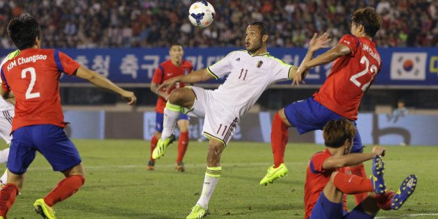 BUCHEON, SOUTH KOREA - SEPTEMBER 05: Juan Falcon of Venezuela competes for the ball with Lim Chai-Min...