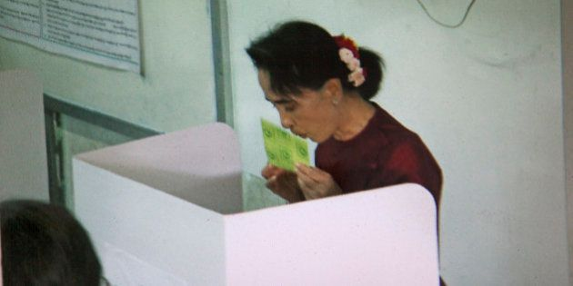 YANGON, MYANMAR - 2015/11/08: NLD leader Aung San Suu Kyi kisses her ballot, at a polling station, during...
