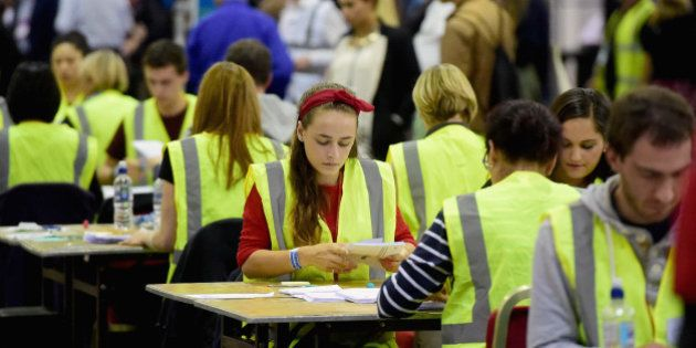 EDINBURGH, SCOTLAND - SEPTEMBER 18: Tellers count votes in the Scottish Independence Referendum at the...