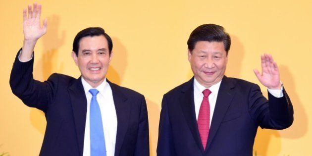 Chinese President Xi Jinping (R) and Taiwan President Ma Ying-jeou wave to journalists before their meeting...