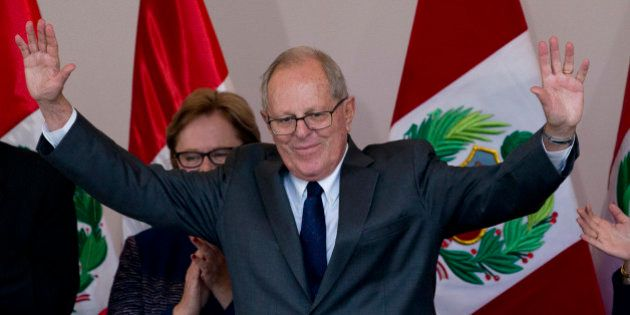 Presidential candidate Pedro Pablo Kuczynski acknowledges the crowd at the end of a news conference in...