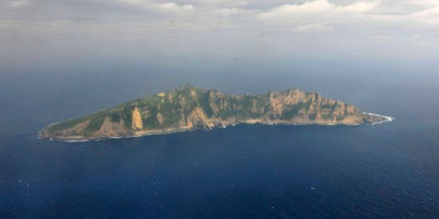 FILE - In this Dec. 13, 2012 file photo released by China's Xinhua News Agency, one of the small islands...