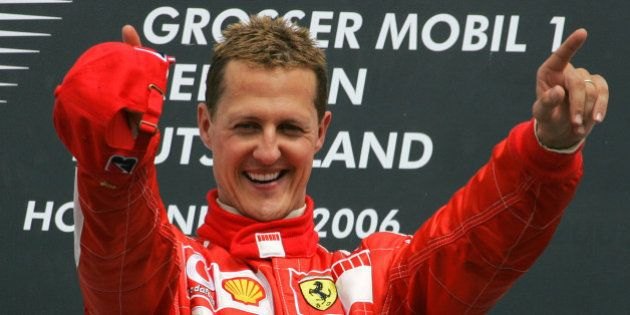 Germany's Ferrari driver Michael Schumacher celebrates during the winner's ceremony of the Formula One...