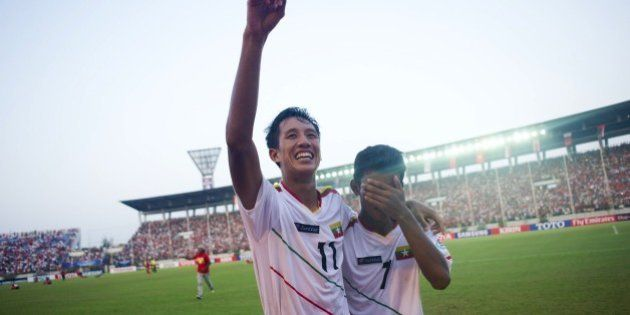 Than Paing of Myanmar (C) celebrates after winning the AFC U-19 Championship quarter-final football match...