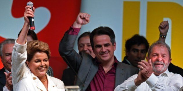 Re-elected Brazilian President Dilma Rousseff celebrates following her win, in Brasilia on October 26,...