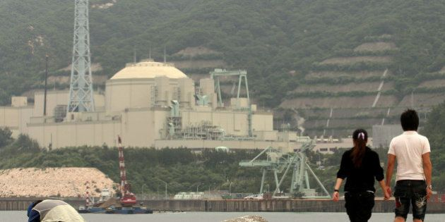 TSURUGA, JAPAN - JUNE 10: A couple walk beside the Monju nuclear reactor, one day before the three month...