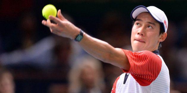 PARIS, FRANCE - NOVEMBER 01 : Kei Nishikori of Japan serves against Novak Djokovic of Serbia (not seen)...