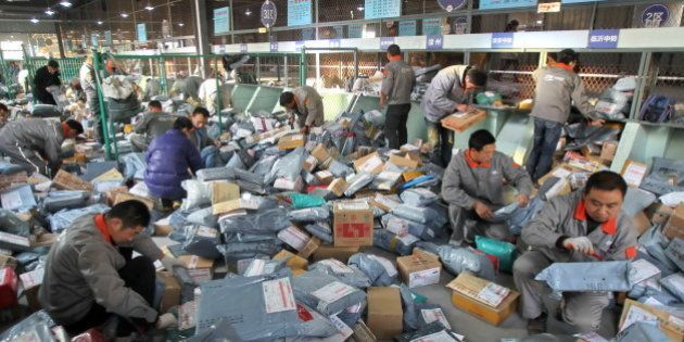 NANTONG, CHINA - NOVEMBER 12: (CHINA OUT) Workers distribute packs at an express company on November...
