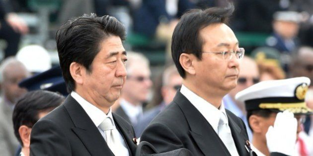 Japanese Prime Minister Shinzo Abe (L) and Defense Minister Akinori Eto (front R) receive the honor guard...