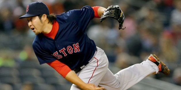 NEW YORK, NY - APRIL 10: Junichi Tazawa #36 of the Boston Red Sox delivers a pitch in the 8th inning...
