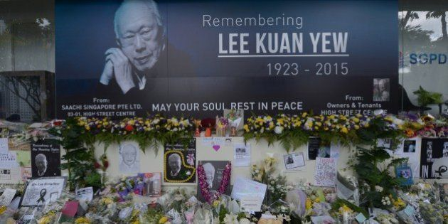 Pictures and flowers are seen in front of a memorial area for Singapore's late former prime minister...