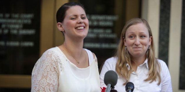 ARLINGTON, VA - OCTOBER 06: Erika Turner (R) and Jennifer Melsop (L) of Centreville, Virginia, rejoice...
