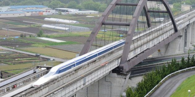 The Maglev (magnetic levitation) train carrying US Transport Secretary Ray LaHood speeds during a test...