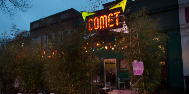 WASHINGTON, DC: DECEMBER 6: Signs of support hang on the building at Comet Ping Pong in Washington, D.C.,...