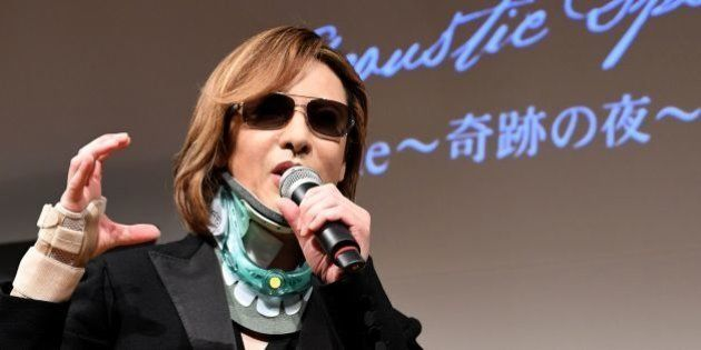 Yoshiki from the Japanese band 'X Japan' wears a neck brace while attending a press conference for his...