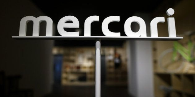 Logo of Mercari Inc. is displayed at the entrance to the company's office in Tokyo, Japan, on Friday,...