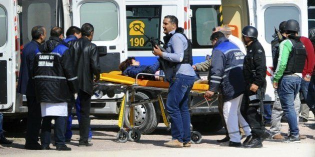 A victim is being evacuated by rescue workers outside the Bardo musum in Tunis, Wednesday, March 18,...