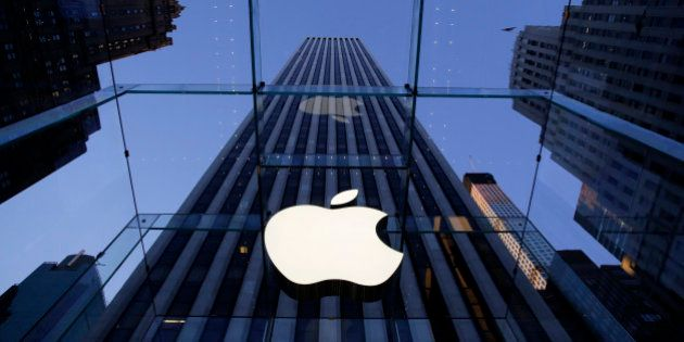 In this Sept. 5, 2014 photo, the Apple logo hangs in the glass box entrance to the company's Fifth Avenue...
