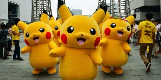Dozens of Pikachu characters, the famous character of Nintendo's videogame software Pokemon, parade at...