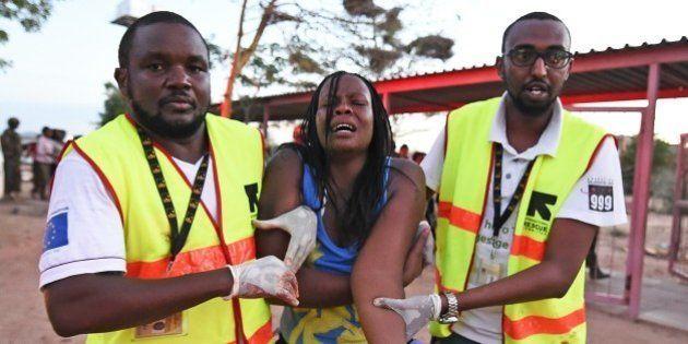 Paramedics help a student who was injured during an attack by Somalia's Al-Qaeda-linked Shebab gunmen...