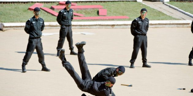 In a picture taken on September 23, 2010 Chinese anti-terrorism police S.W.A.T. unit members show off...