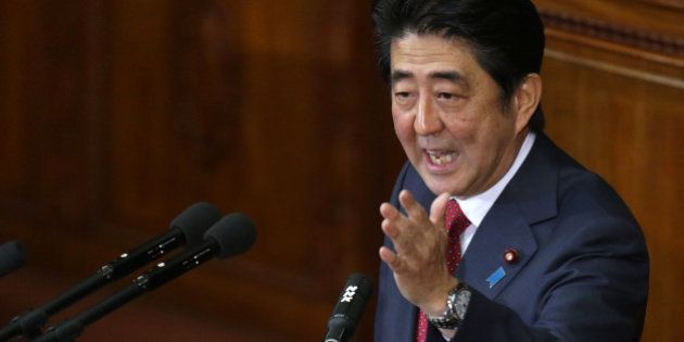 Shinzo Abe, Japan's prime minister, gestures as he delivers his policy speech at the lower house of parliament...