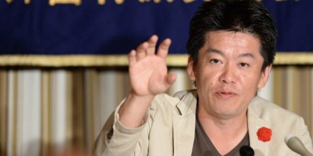Former Livedoor president Takafumi Horie attends the FCC press conference in Tokyo on June 5, 2013. Horie,...