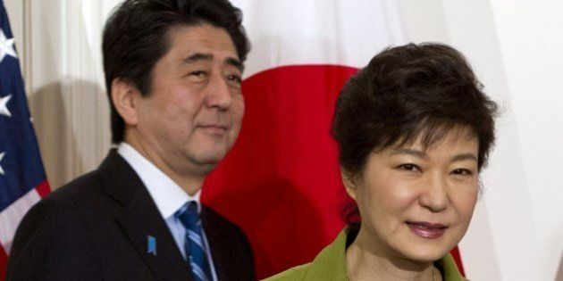 South Korean President Park Geun-hye and Japanese Prime Minister Shinzo Abe arrive for a trilateral meeting...