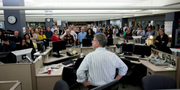 DORCHESTER, MA - NOVEMBER 13: The Boston Globe's Editor Martin Baron announces to the staff that he is...