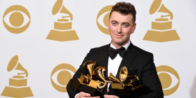 "Sam Smith poses in the press room with the awards for best new artist, best pop vocal album for ""In..."