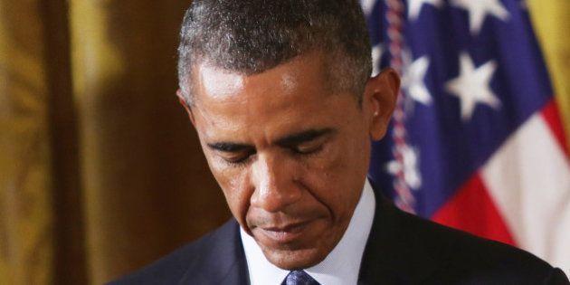 WASHINGTON, DC - SEPTEMBER 15: U.S. President Barack Obama bows his head to prays during an East Room...